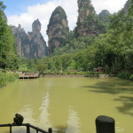 Monkeys relaxing at the entrance to Zhangjiajie National Forest Park